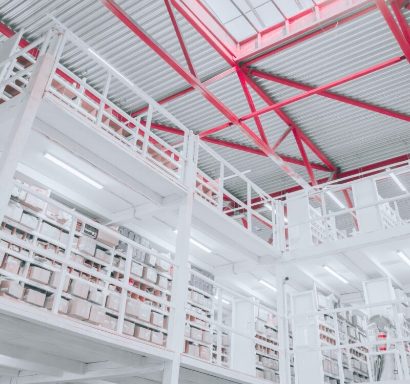 white-metal-frame-warehouse-red-wall